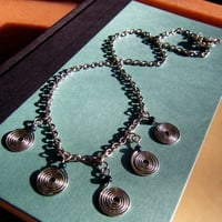 Silver Spiral Hammered Metal Necklace on Chain