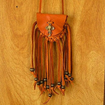 Rust deerskin medicine bag pouch with a brass Elephant Amulet and brass beads with long fringe