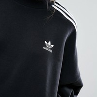 adidas Originals Black Three Stripe High Neck Sweatshirt at asos.com