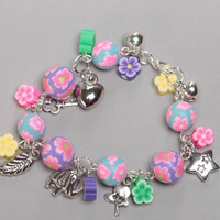 Bright colorful handmade children's polymer clay wrist bracelet with charms