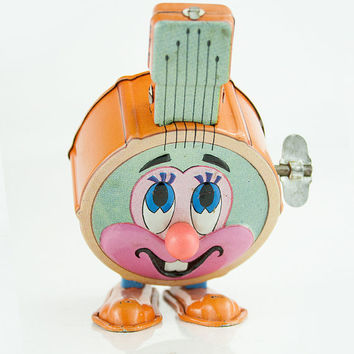 Vintage Marx tin windup toy hopping bittie banjo
