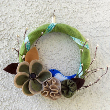 Woodland nature felt and yarn wreath with blue bird.