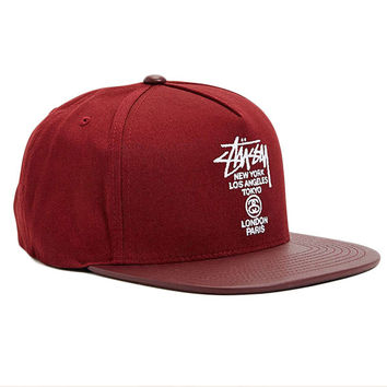 The World Tour Maroon Snapback Hat by Stussy