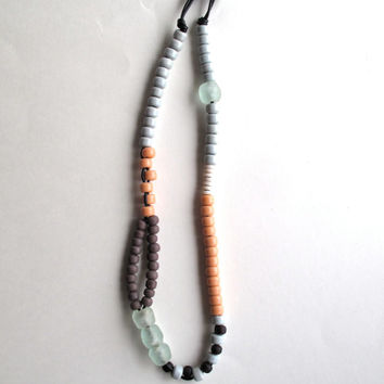 Beaded asymmetrical necklace Native American gray plum mauve and peach glass beads African beads on black leather cord