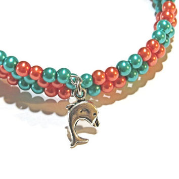 Miami Dolphins Memory Wire bracelets.  Aqua Blue and orange Czech glass beads on 3 coils of memory wire.  Sizes small child to XL adult