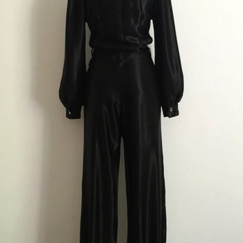 Vintage 1970s 'Geoff Bade' black satin jumpsuit with zip front and silver topstitching / Size 12
