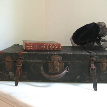 Vintage black leather suitcase ~ fallen on hard times, but not down and out
