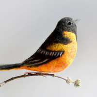 The felt handmade bird - The Baltimore oriole is the state bird of Maryland and also the inspiration for local baseball club.