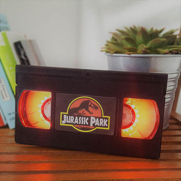 Retro VHS Jurassic Park Jurassic World Night Light Table Lamp. Order any film, movie, series, or actor! Great personal gift. Man Cave.