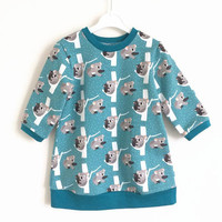 Girls sweater dress with long sleeves. Sweat fabric with koala bears. Toddler dress. Teal. Sizes 12 months to 5T.