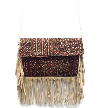 Boho chic tri-Fabric hand stitch tapestry-like-embroidered embellished crossbody bag, genuine suede fringe trim, multi colored & mirrors accents at side. Inside features one zip and tow slip pockets. Non-adjustable woven bone colored leather strap, finish