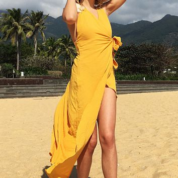 Selling V-neck and dew-back dress with bow tie and holiday beach sling