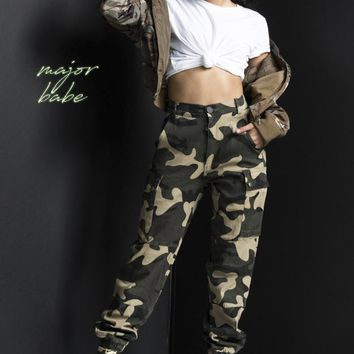 AKIRA High Waist Zip Up Camouflage Print Buckle Strap Detail Pants in Camo