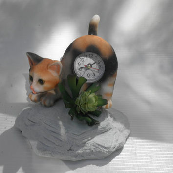 Cat with Wagging Tail / Battery Operated(batteries included).Sand cast base / faux succulent plant