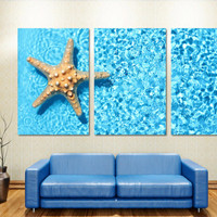 Starfish in blue water - 3 Panel Split, Triptych Canvas Print. Multi wall art print for home, office or living room decor & interior design