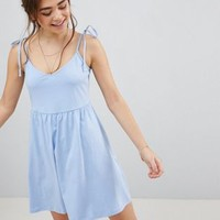 ASOS DESIGN mini smock sundress with tie straps at asos.com
