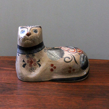 The Surprise. Tonala cat figurine, Mexican pottery. Cat loaf.