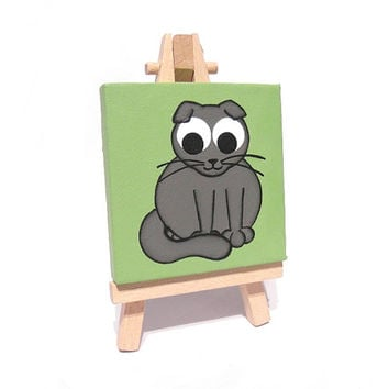 Scottish Fold Mini Cat Painting - small acrylic artwork of a cute grey cat with folded ears, green miniature canvas on easel