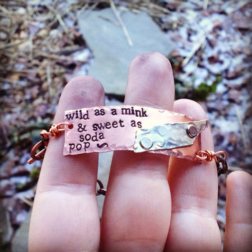 unique hand stamped wild as a mink and sweet as soda pop rocky top inspired bracelet