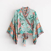 FLOWERS BY THE SEA WRAP TOP
