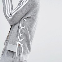 adidas Originals Lace Up Three Stripe Bomber Jacket at asos.com
