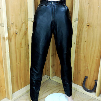 Wilsons black leather pants / size 7 / 8 /  80s ladies leather biker pants / high waisted black rocker pants