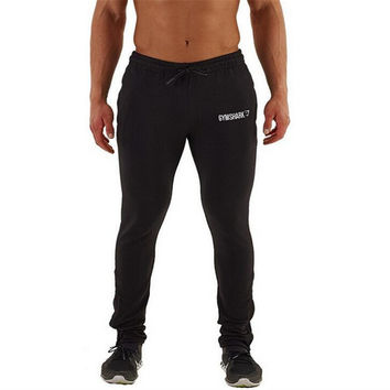 2017 Muscle men's bodybuilding pants men runs fitness pants gyms man trousers black xxl slim sporting man pants soft sweatpants
