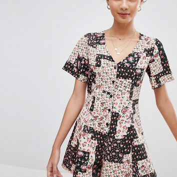 ASOS DESIGN Swing Playsuit With Button Front In Patchwork Floral Print at asos.com
