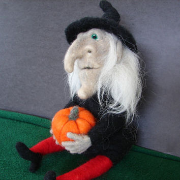 Halloween Witch table decoration, hand made needle felted from wool and holding her pumpkin.