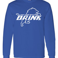 This Team Makes Me Drink,  professional screen printed long sleeve t shirt.  This royal t shirt is printed with white ink.