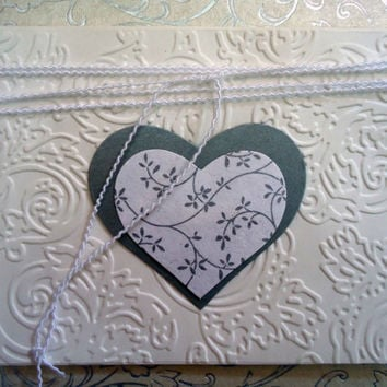 Card in whites and silvers with heart. Card with white and silver heart. Card for her/him.