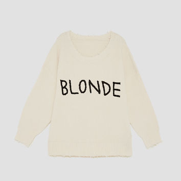 SWEATER WITH FRONT SLOGAN