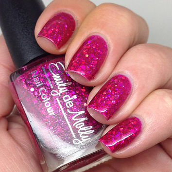 "Nail polish - ""Fashion Victim"" pink holographic glitter in a pink jelly base"