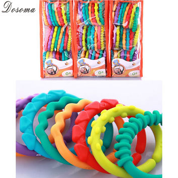 Baby Cute Rainbow Circle Comic Molars Dental Apron The Clutch Ring 24pcs Baby Tooth Chewing Colorful Teether