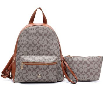 Coach fashion casual lady's backpack is a hot seller of shopping backpacks with printed patchwork color #1