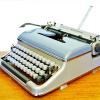 1962 Blue Bird Deluxe Vintage Portable Working Typewriter Torpedo made in Germany metal body with case and manual refurbished metallic blue