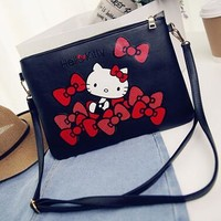 Hello kitty  clutch purse / crossbody bag with adjustable detachable strap