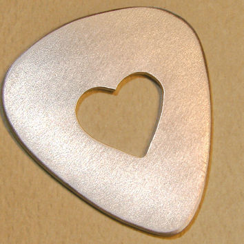 Heart shaped guitar pick in aluminum for you to personalize
