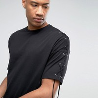 ASOS TALL Oversized T-Shirt With Eyelets And Lace Up Sleeve Detail at asos.com