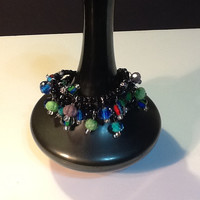 Kaleidoscope crystal bracelet with button closure