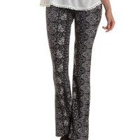 Black/White Paisley Print Knit Flare Pants by Charlotte Russe