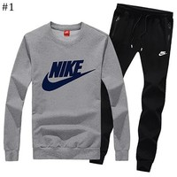 NIKE winter new plus velvet men's slim sports trousers round neck sweater two-piece #1