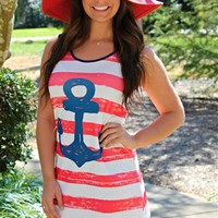 Sleeveless red and white striped dress with navy anchor on the front.