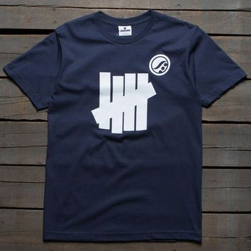 Undefeated x SYR Men Strike Tee (navy)