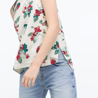 White Floral Print sleeveless Side Slit Blouse With Pocket