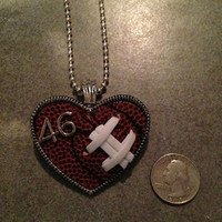 Football Softball and Baseball Heart Pendant with real sports balls used.