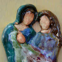 Handcrafted Pottery Family Set  .  Sculpture in  Pottery ceramic of a Family.  Ceramic tile on a stained wood by Elena Madureri