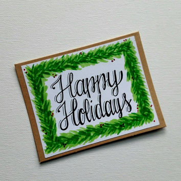 Hand lettered 'Happy Holidays' greeting card, holiday greens festive card, blank Kraft Christmas card.