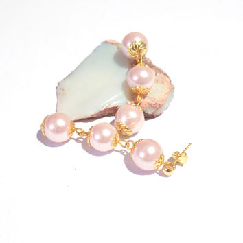 Pink and gold dangly earrings