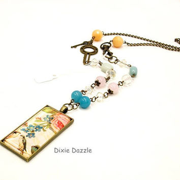 Vintage art pendant, asymmetrical necklace, semiprecious gemstones, domino jewelry, boho style, bronze key, front closure necklace, bird art